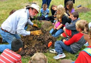 Foundation VA showing kids how to plant a tree